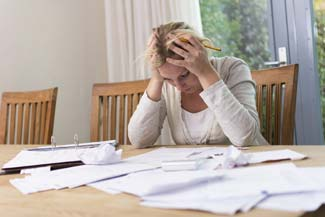 frustrated-woman-paperwork